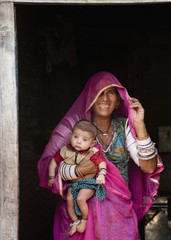 Indian woman holding baby boy