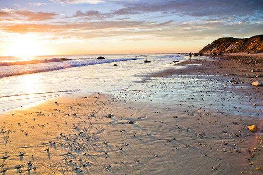 Waves washing up on rocky beach