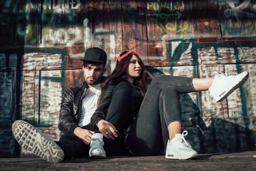 Young urban couple posing Wall mural