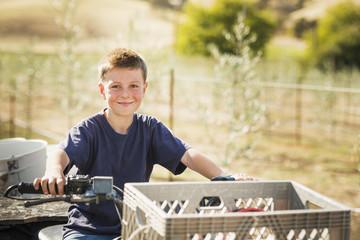 Caucasian boy driving four wheeler outdoors