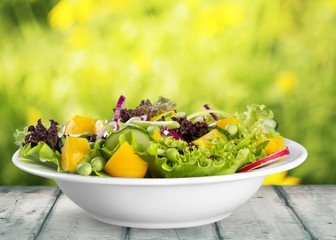 Wall Mural - Salad. Set with different salads on white background