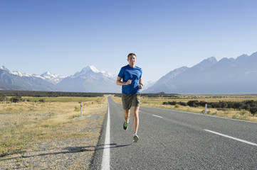 Caucasian man running on rural road