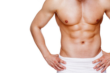 Athletic muscular man in towel, isolated over white background