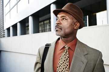 Black businessman standing on city street