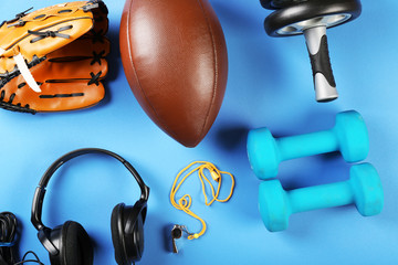 Sports equipment on color table, top view