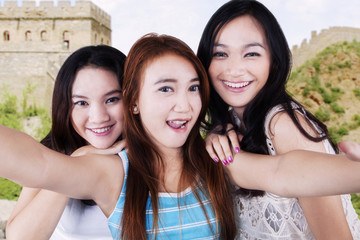 Attractive girls taking picture at Great Wall