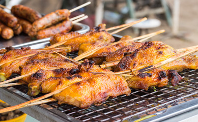 grilled Chicken on the grill side of the road.