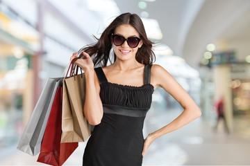 Fashion. Beautiful brunette young woman wearing dress and