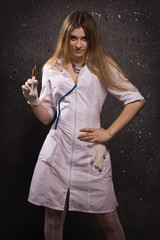 Nurse with a disposable syringe
