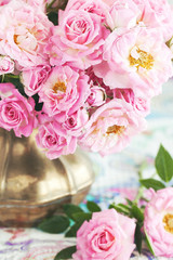 Floral composition with a pink  roses in a vintage jug .