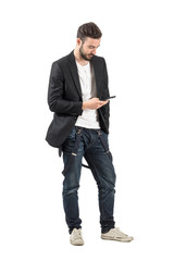 Young man using mobile phone isolated