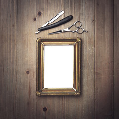 Vintage picture frame and barber tools on wood desk