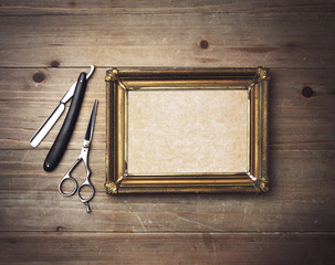 Kraft canvas with a frame and vintage barber tools