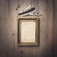 Kraft canvas with a vintage frame and barber tools
