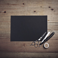 Old style barber tools and black page
