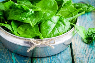 raw fresh organic spinach in a bowl closeup