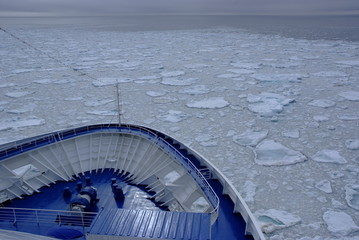 Cruise Ship bow passing icy snow arctic waters Spitsbergen