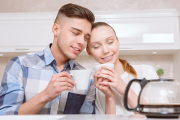 Young couple sitting and drinking coffee
