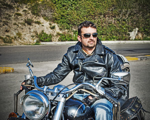 biker on a classic motorcycle in hdr