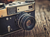 old vintage camera closeup on wooden background