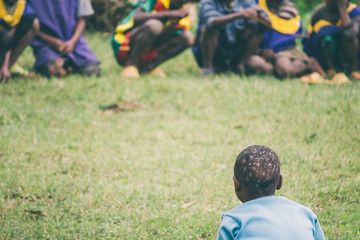 Ethiopian boy sitting on the grass in the nursery