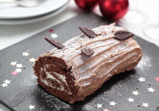 Yule log cake on a Christmas table