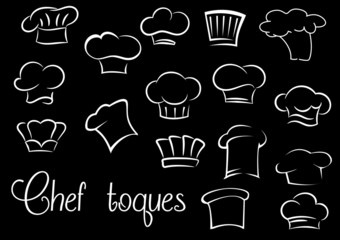 Chef toques and baker hats on black background