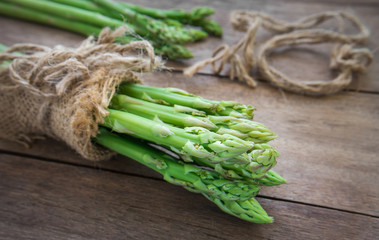 Bunch of asparagus on old wooden table