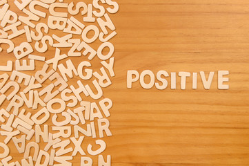 Word positive made with block wooden letters
