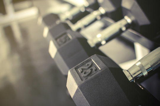 Rows of dumbbells on a rack