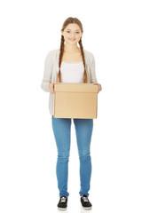 Young woman holding carton box.