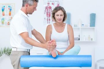 Doctor examining his patients leg