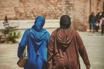 Two moroccan women dressed in typical djellaba