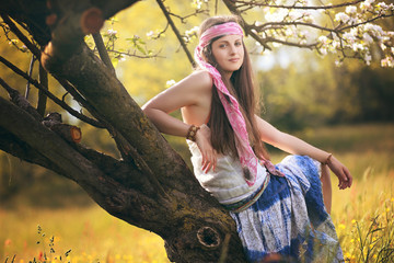 Beautiful young hippie woman posing
