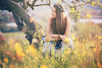Beautiful hippie woman with summer flowers