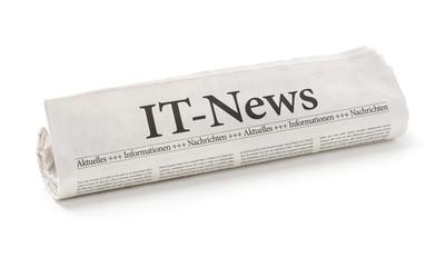 Zeitungsrolle mit der Überschrift IT-News