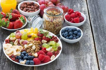 ingredients for a healthy breakfast - berries, fruit, muesli
