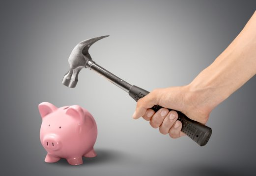 Piggy Bank. Getting at Your Savings