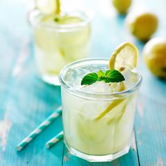 fresh ice cold lemonade with mint and lemon garnish