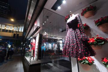 mannequin in fashion shop display window