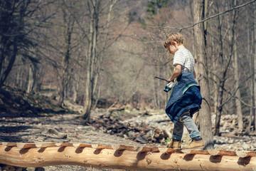 Boy walk in spring forest