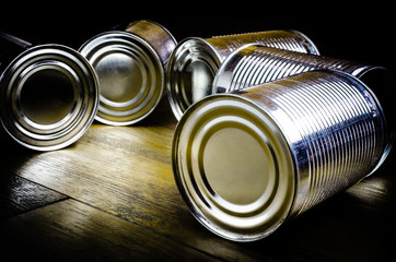 Aluminum cans on wooden background