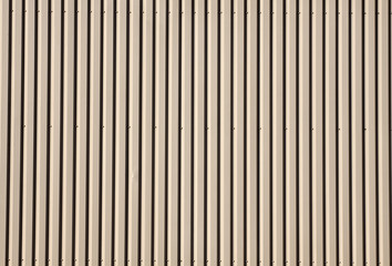 Pattern creme colored  corrugated wall.