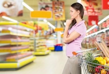 Supermarket. Choosing a good sunflower-seed oil
