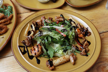 Salad with quid on the plate