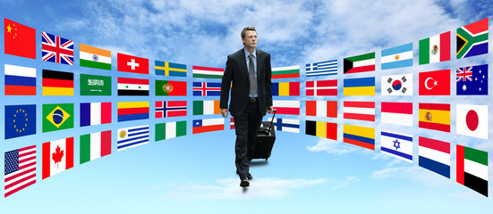 international businessman travel on background of flags