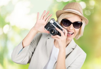 Woman. Young woman making photos with vintage film camera at