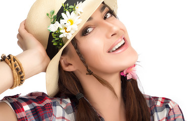 Happy Fashionable Woman Wearing a Hat with Flowers