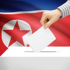 Ballot box with national flag on background - North Korea