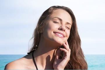 Face. Suntan Lotion Woman Applying Sunscreen Solar Cream